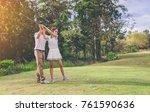 woman golfer doing practice... | Shutterstock . vector #761590636