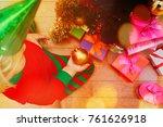 little girl decorating... | Shutterstock . vector #761626918