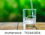 a glass of water on green... | Shutterstock . vector #761661826