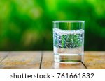 a glass of water on green... | Shutterstock . vector #761661832