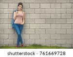 fashion woman in denim standing ... | Shutterstock . vector #761669728