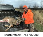 happy hunter with a whitetail... | Shutterstock . vector #761732902