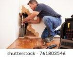 middle aged man repairing burst ... | Shutterstock . vector #761803546