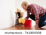 worried woman mopping up water... | Shutterstock . vector #761804308