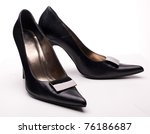 Close-up of female black high-heeled shoes over white background isolated, a lot of copyspace available. - stock photo