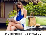 happy traveling woman using... | Shutterstock . vector #761901532