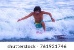 riding the waves. jaco beach ... | Shutterstock . vector #761921746