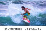 riding the waves. jaco beach ... | Shutterstock . vector #761921752