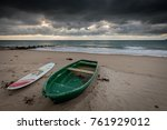 dramatic sky on beach at sunrise | Shutterstock . vector #761929012