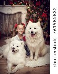 A Girl With A White Dog By The...