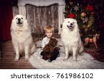 A Boy With A White Dog By The...