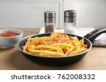 frying pan with french fries... | Shutterstock . vector #762008332