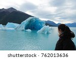 woman observing the ice floe on ... | Shutterstock . vector #762013636