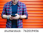 young man using a smartphone in ... | Shutterstock . vector #762019456