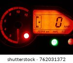 Small photo of A Bike Speedo meter in orange light.