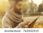 man with beard using tablet... | Shutterstock . vector #762032515