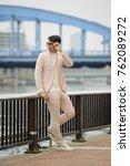 asian young man outdoors posing ... | Shutterstock . vector #762089272