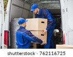 two young male movers carrying... | Shutterstock . vector #762116725
