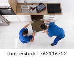 two young male movers in... | Shutterstock . vector #762116752