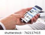 close up of a businessperson's... | Shutterstock . vector #762117415