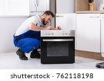 young male repairman repairing... | Shutterstock . vector #762118198