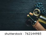a bottle of wine with glasses...   Shutterstock . vector #762144985