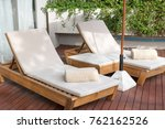 relax on sun lounger towels on... | Shutterstock . vector #762162526