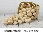 a basket of scattered white... | Shutterstock . vector #762175522