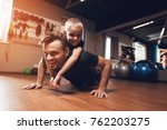 father and son in the gym.... | Shutterstock . vector #762203275