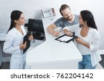 a man and a woman came to see a ... | Shutterstock . vector #762204142