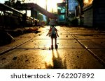 Small photo of BANGKOK, THAILAND - NOVEMBER 23, 2017: Miniature Yotsuba Koiwai anime figure standing on the road with beautiful sunset background. It's famous Japanese comedy maga series.