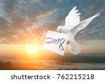 dove carrying 2018 text in... | Shutterstock . vector #762215218