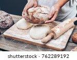 baker preparing a variety... | Shutterstock . vector #762289192