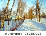 metal fence and snow covered... | Shutterstock . vector #762387328