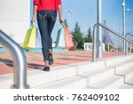 woman walking out from a... | Shutterstock . vector #762409102