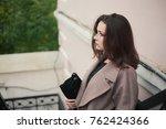 business woman walking on street   Shutterstock . vector #762424366