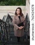 business woman walking on street | Shutterstock . vector #762424378