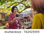 women friends toasting red wine ... | Shutterstock . vector #762425455
