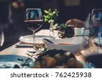 glass of red wine at dining... | Shutterstock . vector #762425938
