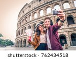 young couple at the colosseum ... | Shutterstock . vector #762434518