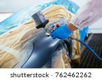 man with protective clothes and ... | Shutterstock . vector #762462262