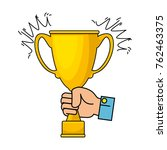 hand with trophy cup award icon | Shutterstock .eps vector #762463375