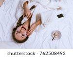 happy young girl woke up  lies... | Shutterstock . vector #762508492