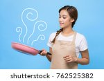 cooking young woman. | Shutterstock . vector #762525382