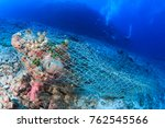 an abandoned fishing net  ghost ... | Shutterstock . vector #762545566