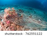 an abandoned ghost net wrapped... | Shutterstock . vector #762551122