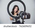 beauty blogger. makeup tutorial.... | Shutterstock . vector #762609652