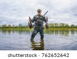 Small photo of A hunter holding a duck in his hands