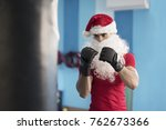 fitness santa claus boxing... | Shutterstock . vector #762673366