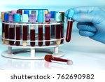 doctor with tubes rack and... | Shutterstock . vector #762690982